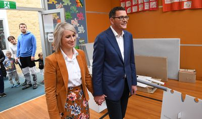 Victorian Labor leader Daniel Andrews and his wife Catherine wait to vote at Albany Rise Primary School in Mulgrave in Melbourne.
