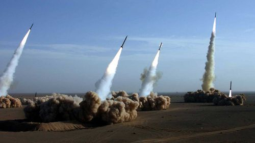 Iran's elite Revolutionary Guards tests missiles during maneuvers in a central desert area of Iran.