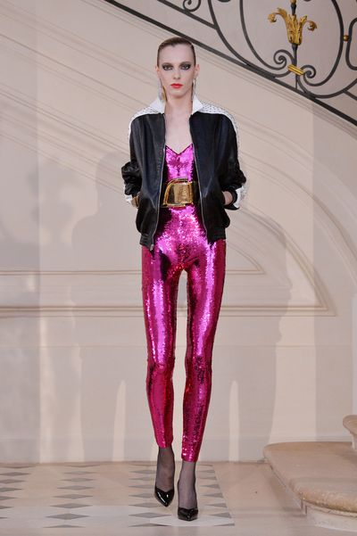 Given her penchant for skin-tight trousers and sporty/street style, what better than Saint Laurent's demi-couture, glam rock metallic sequin jumpsuit?