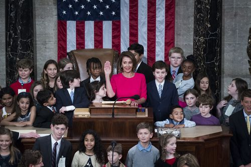 Democratic Speaker of the House Nancy Pelosi, surrounded by her grandchildren and the children of other lawmakers.