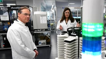 Federal Health Minister Greg Hunt (left) tours the National Drug Discovery Centre at the Walter and Eliza Hall Institute of Medical Research in Melbourne. The Federal Health Minister Greg Hunt has announced $66 million in Coronavirus related research which includes $30 million already pledged