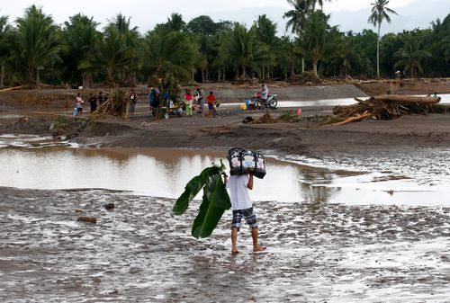 Officials said 160 other people were missing after being swept away. (AAP)