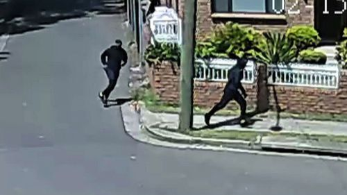 Masked men could be seen running from the scene of the gym where Hawi was gunned down.