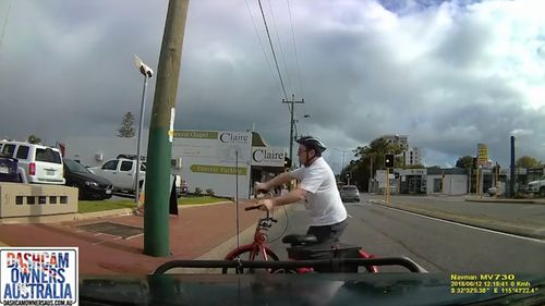 The cyclist was visibly stunned but was able to stand unassisted. (Dashcam Owners Australia)