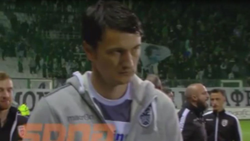 Beer can hits PAOK manager Vladan Ivic during Greek playoff against Panathinaikos