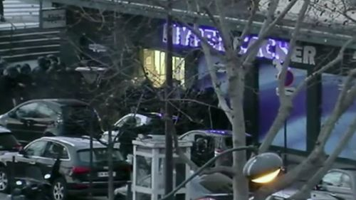 Police surround the Kosher supermarket stormed by Coulibaly in January. (9NEWS)