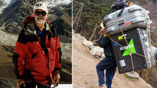 Retired US engineer Garry Porter, left, and  a Nepalese porter.