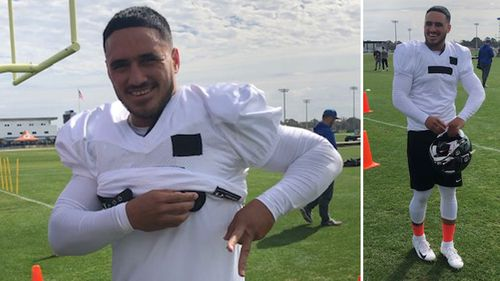 Valentine Holmes tries on the pads for size at Florida's IMG Academy.