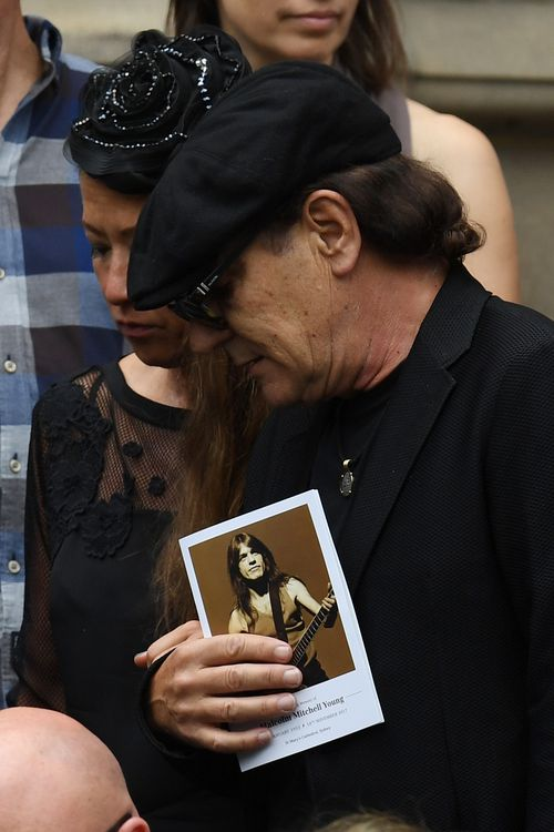 Lead singer Brian Johnson clutches an order of service. Picture: AAP