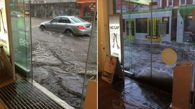 Water splashes against the front windows of the Specsavers store in Burke Road, Camberwell. (@ptingate)