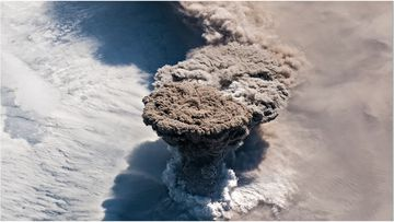 Out-of-this-world photos show plumes of smoke and debris from a volcano near Japan erupting into the atmosphere.