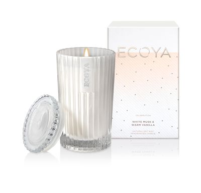 "<a href=""https://www.ecoya.com/ecoya/shop/Shop+by+Collection/Celebration/White+Musk++Warm+Vanilla++Celebration+Candle+Jar.html#.WJp6L1V95aQ"" target=""_blank"">Ecoya Celebration Collection Candle in White Musk and Vanilla, $39.95.</a>"