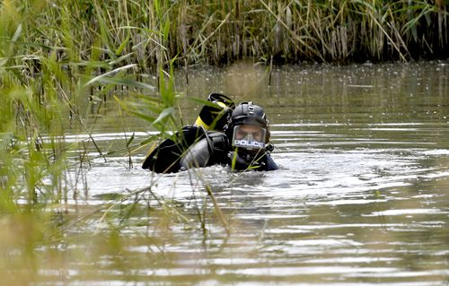 Police divers are searching for items including a hunting knife, a dark coloured jacket and gloves in the Christie Creek catchment.