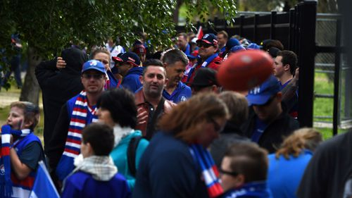 Bulldogs supporters line up at Whitten Oval