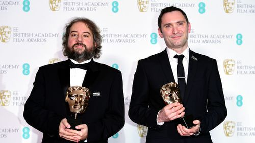 Paul Machliss and Jonathan Amos with their award for Editing in the press room at the EE British Academy Film Awards held at the Royal Albert Hall in London. (AAP)