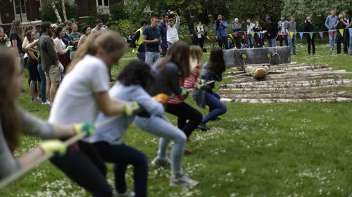 Volunteers heave a one-tonne rock during a University College London experiment. (AP)