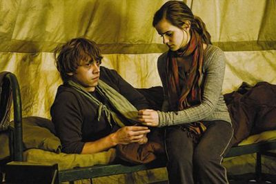 Emma Watson and Rupert Grint in the Harry Potter movies, with total global box office takings of $4.2 billion. Go Ron and Hermione!