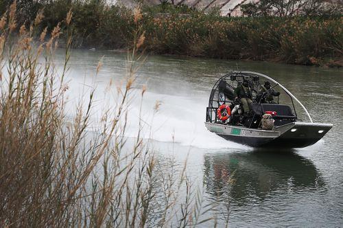 Border Patrol agents patrol the Rio Grande