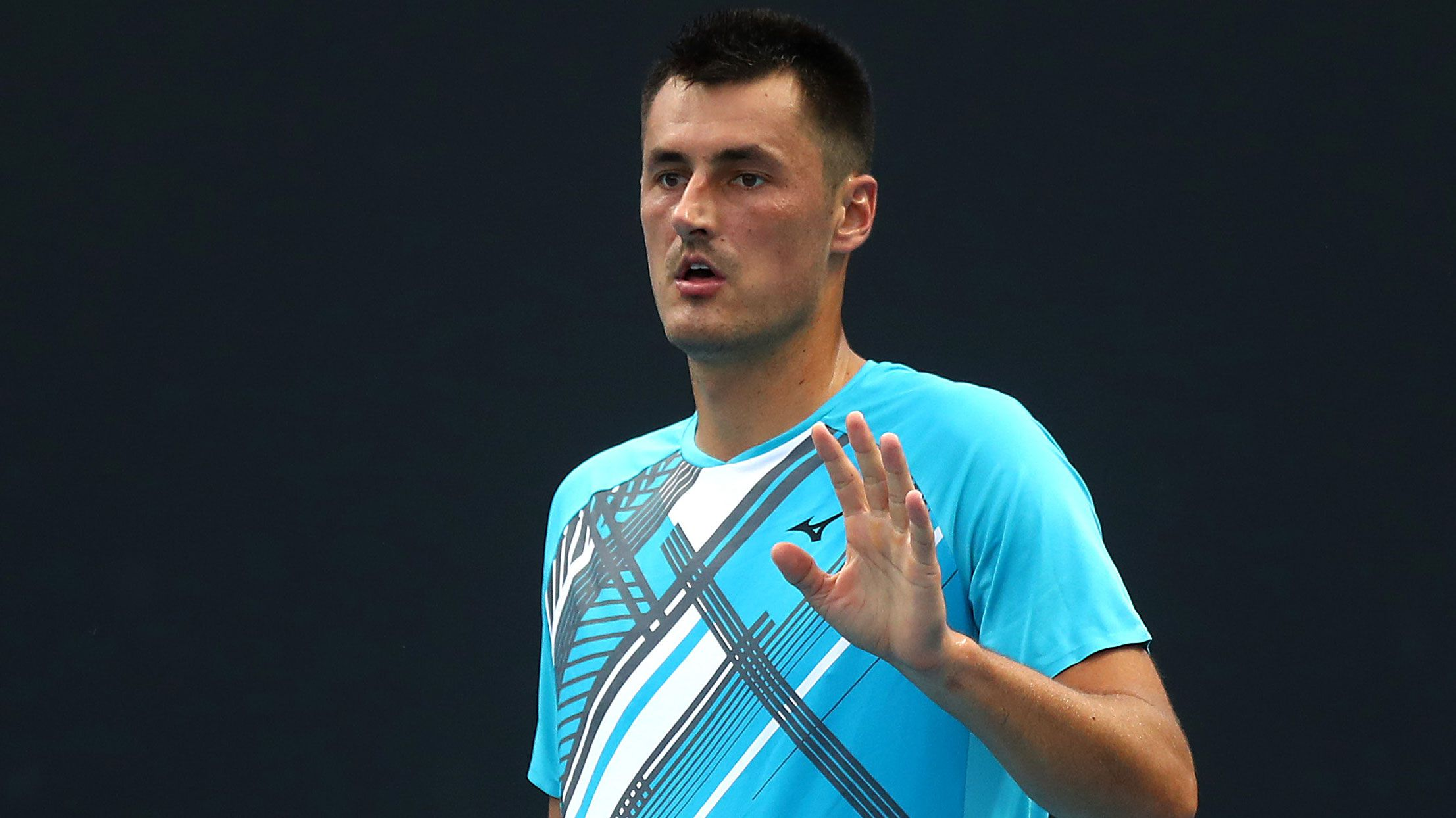 Bernard Tomic in action in the first round of the Australian Open.