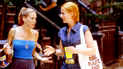 Carrie and Miranda talking and walking down the street in Sex and the City.