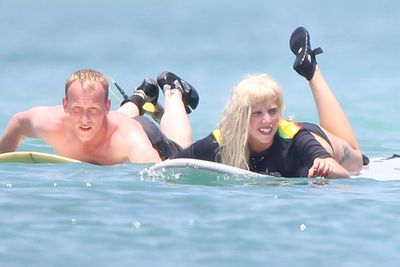 A month before the <i>Harper's</i> cover hit the stands, Gaga went surfing in Mexico... you guessed it, WITHOUT MAKEUP! But not without her trusty wig...