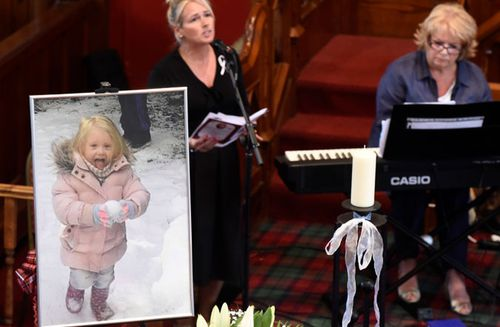 A file photo of last year's funeral of six-year-old Alesha MacPhail, whose body was found in woodland on a Scottish island.