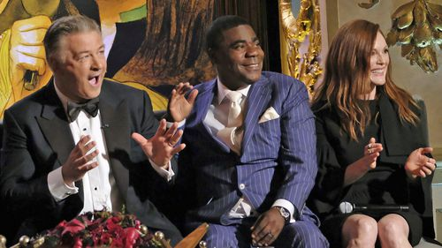 "Alec Baldwin, left, Tracy Morgan and Julianne Moore attend Spike TV's ""One Night Only: Alec Baldwin"" at the Apollo Theater in 2017."