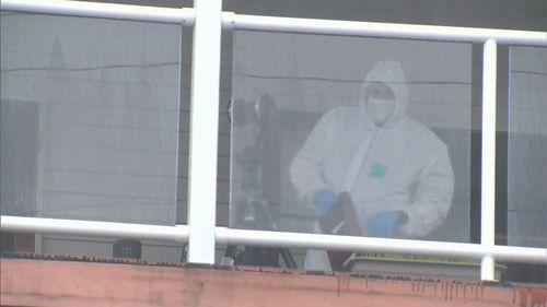 Forensic officers pictured at the scene this morning. Picture: 9News