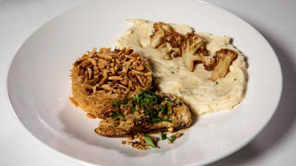 The Sharouk's tahini baked samka hara fish, sayidiya rice, cauliflower and potato mash with fried cauliflower