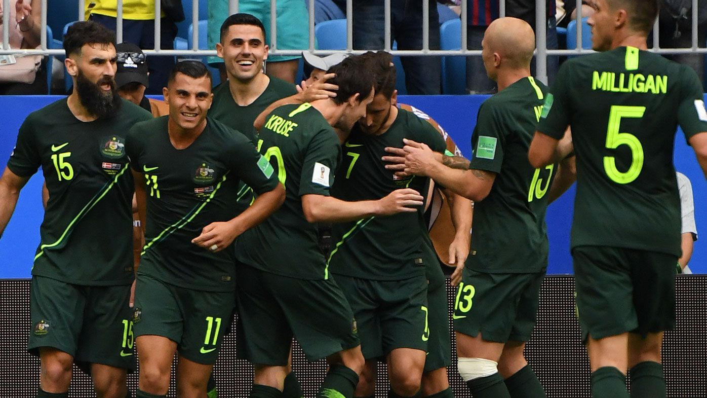 The Socceroos celebrate Mile Jedinak's goal against Denmark.