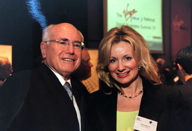 Meeting former Prime Minister John Howard at a corporate event.
