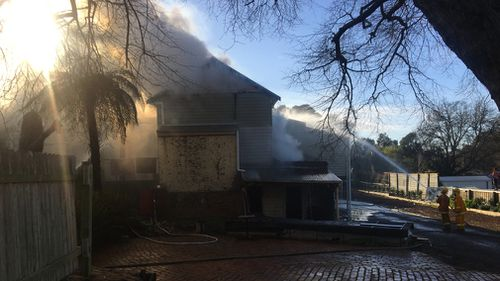 More than 50 firefighters are still battling the fire, and there are concerns the property could contain asbestos.