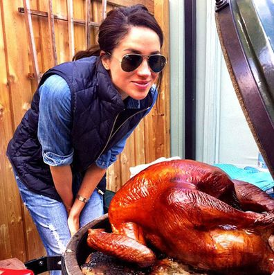 Meghan Markle cooking a Thanksgiving turkey in 2016