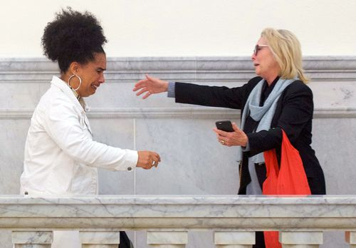 Bill Cosby accusers Lili Bernard, left, and Victoria Valentino, right, reach out to embrace outside the courtroom after Cosby was found guilty in his sexual assault retrial.
