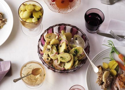 Warm potato salad with celery, red onion and capers