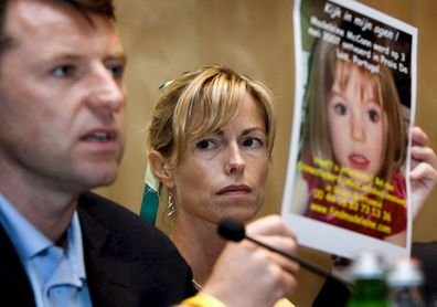 Gerry and Kate McCann, parents of missing British girl Madeleine McCann, show a picture of their daughter at a press conference in Amsterdam, Netherlands in June 2007.