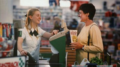 A Woolworths employee serves a customer in 1997. (Supplied)