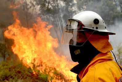 Firefighters backburn along Putty Road in Colo Heights in Sydney, Saturday, November 16, 2019. High temperatures, low humidity and gusty winds are threatening NSW this weekend, with severe fire danger ratings for regions in the north of the state. (AAP Image/Jeremy Piper) NO ARCHIVING