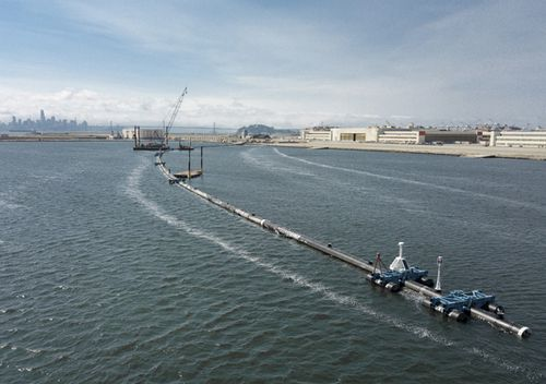 A long floating boom that will be used to corral plastic litter in the Pacific Ocean is assembled in Alameda, California. Engineers will deploy a trash collection device to corral plastic litter floating between California and Hawaii in an attempt to clean up the world's largest garbage patch.
