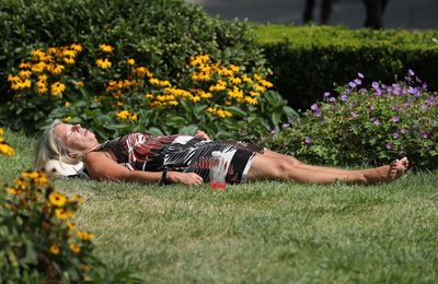 A woman sunbathing in St Paul's Cathedral Churchyard Gardens in London as the heatwave continues in parts of the UK.