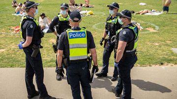 Victoria Police patrol at St Kilda beach.