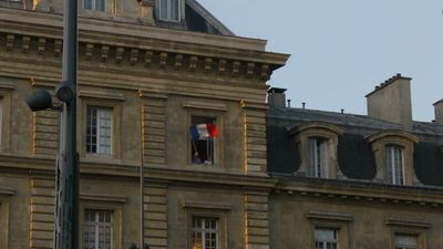 Residents above Place de la Republique fly the French flag proudly. (Jack Hawke, 9News.com.au)