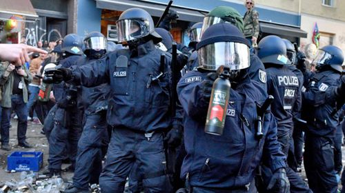 German police deploy pepper spray against protesters in the city of  Berlin. (AP).
