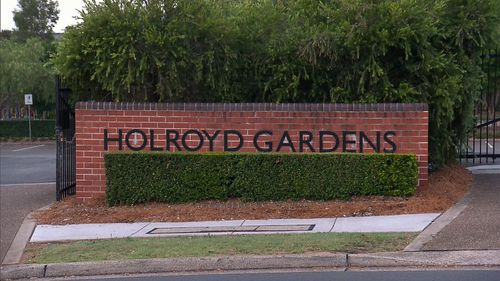 The man pushed the woman from behind as she neared the entrance to Holroyd Gardens.