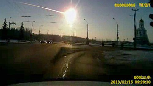 In this February 15, 2013 image made from a dashboard camera video, a meteor streaks through the sky over Chelyabinsk, in eastern Russia. (AP).