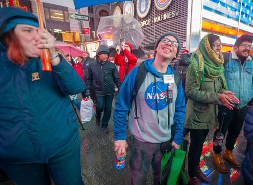 Space enthusiasts gathered in a chilly Times Square in New York to watch the Mars landing.
