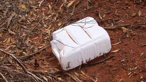 An empty water container was found near his car.
