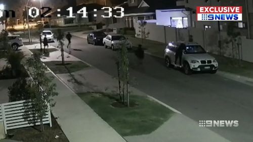 Ten youths were filmed descending on the suburban street at 2am on Christmas Eve.