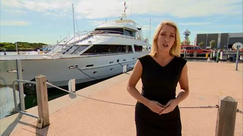 ACA's Tineka Everaardt with the yacht Mr McAuliffe is now living on.