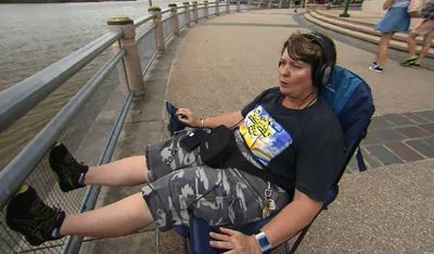 This woman was keen to nab a spot at the South Bank Parklands ahead of Brisbane's fireworks displays. (9NEWS)